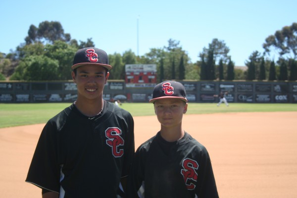 Chris Puckett (left), 15, and Cameron Shelley, 14, volunteered to coach the San Clemente Little League American No. 2, leading the team to a District 68 Tournament of Champions title. Photo by Steve Breazeale