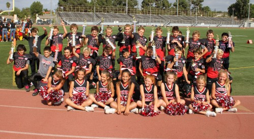 The South Coast Tritons Junior Pee Wee Red football team, along with their cheerleaders, will play against Carson Ravens on November 23. Courtesy photo