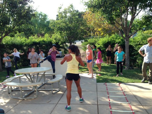 Cindi Juncal and trainers from So Cal Boot Camp help get kids moving and talking about good nutrition during a family night at the Mendocino Apartments in San Clemente. Courtesy photo