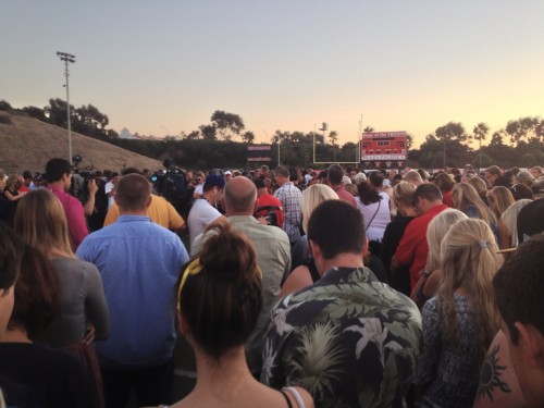 Hundreds gather on the field at San Clemente High School to mourn the loss of Nick Pasquale. Photo by Jim Shilander