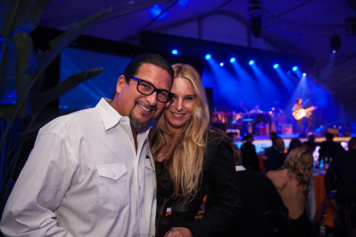 "Surfers Healing founders Isreal ""Izzy"" Paskowitz and wife Danielle Paskowitz enjoy a performance by Jackson Browne at their Night to Benefit Autism, Jan. 18 in Dana Point. Photo by Paul Gero"