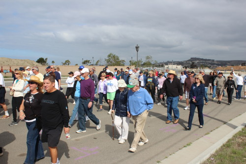 San Clemente residents take some of the first steps onto the Outlets at San Clemente Plaza project site before construction is set to begin. Photo by Jim Shilander