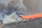 A plane drops fire retardent on the newest fire at Camp Pendleton, Photo by Andrea Swayne