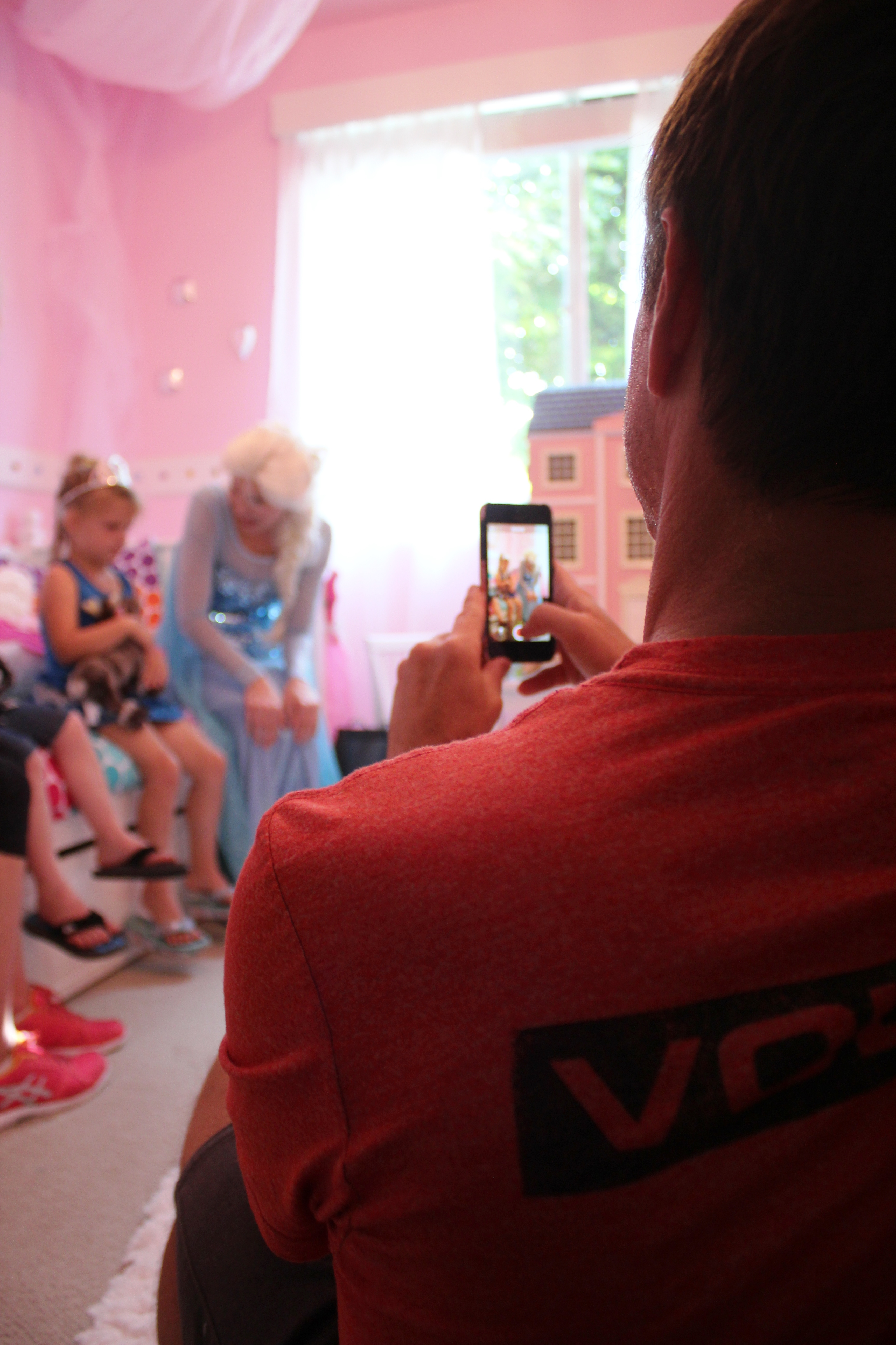 """From her newly decorated bedroom, Greg Beckler films daughter Raelyn, 5, and Queen Elsa, played by Kaylin Omo, sing """"Let It Go"""" from Disney's feature film Frozen. Raelyn's room was redone by volunteers from the nonprofit Special Spaces. Photo: Andrea Papagianis"""