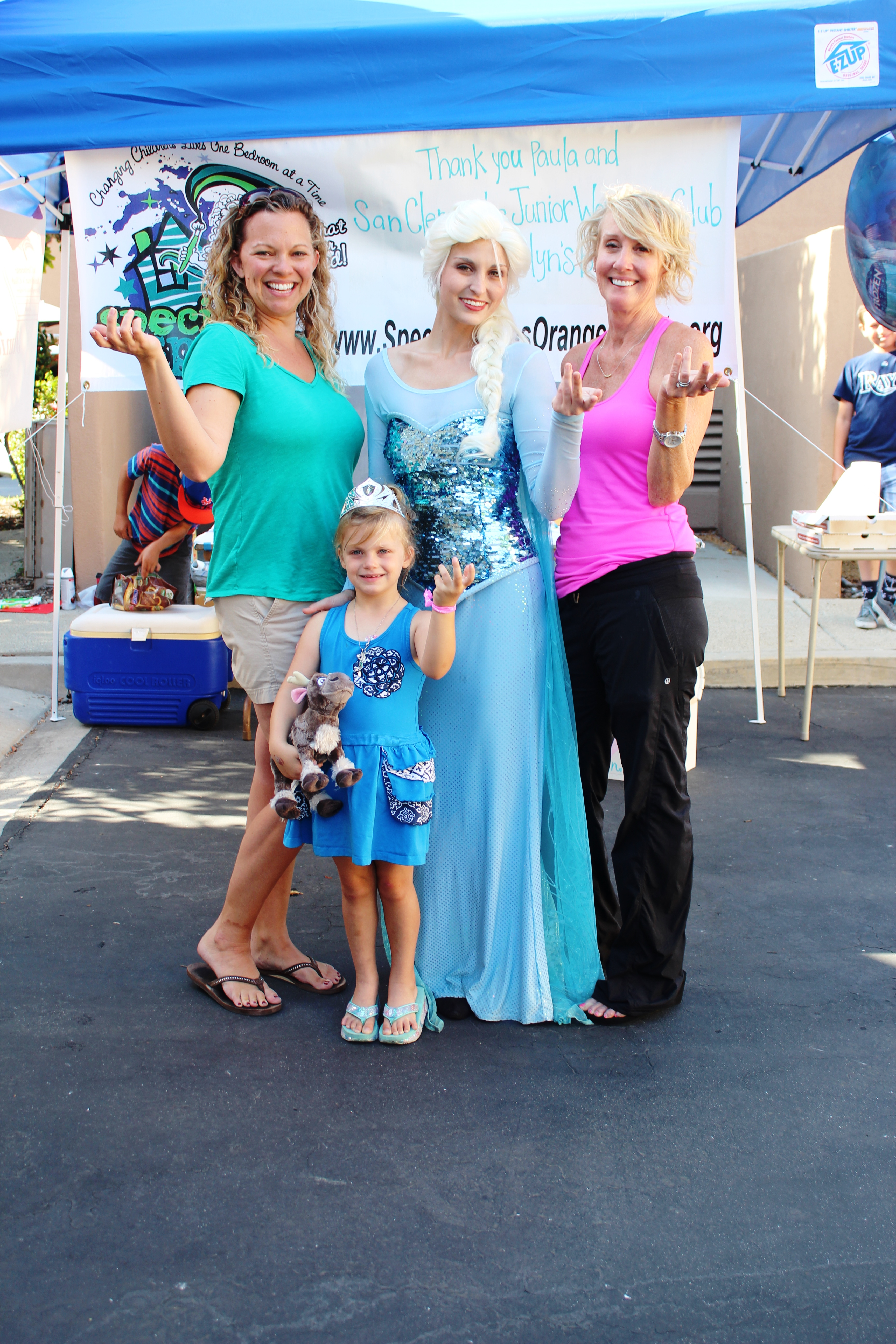 Members of the San Clemente Junior Women's Club, including Paula Oblen (right), join Queen Elsa and Raelyn Beckler in the ice-queen pose from Disney's Frozen. A donation from SCJWC and Oblen's design helped Special Spaces give Raelyn a new bedroom. Photo: Andrea Papagianis
