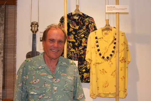 Aloha Spirit Hawaiian Shirts & Ukuleles in California Beach Culture exhibit curator Jim Kempton pauses for a photo on opening night. Photo: Andrea Swayne