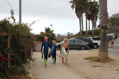Liam Matteer, Hana Johnson and Hagen Johnson set out for a day of surfing at San Clemente State Beach Tuesday. The State Parks system celebrates its sesquicentennial next month. Photo: Andrea Swayne