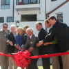 Councilman Bob Baker and other dignitaries officially open the Cotton's Point Senior Apartments Oct. 15. Photo: Steve Sohanaki.