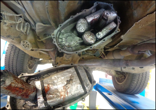 Border Patrol agents discovered a cache of drugs under a truck in this 2014 photo. Photo: Courtesy