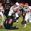 San Clemente's Triston Morgan (8) forces Fullerton's David Wagner to fumble on a kick return during the first quarter of play on Nov. 14. Photo: KDahlgren Photography