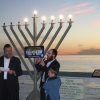 The Chabad Center of San Clemente hosts its annual Menorah lighting at the San Clemente Pier Sunday. This photograph is from last year's event. Photo by Quinn Conway.