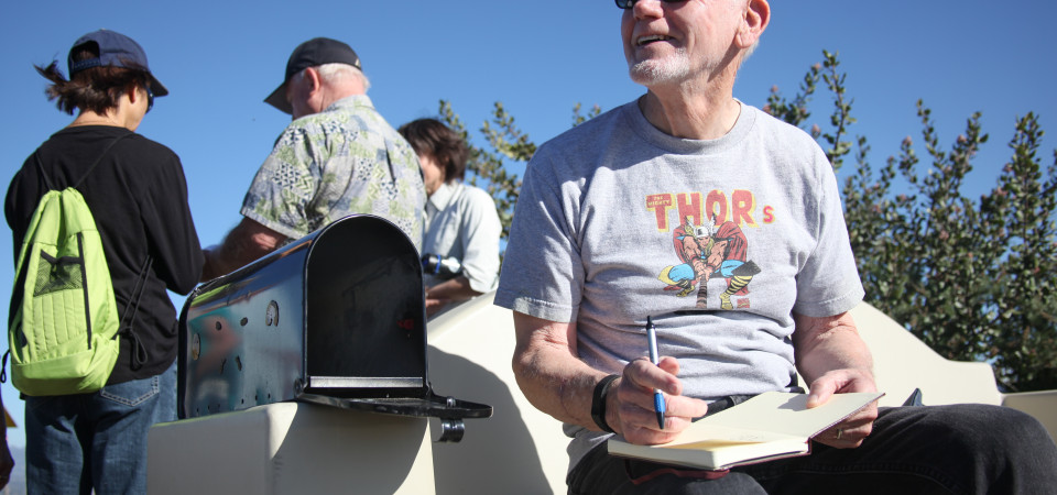 Jim Thordahl of San Clemente signs the new summit journal he brought to replace the full one, the second of two that were filled with signatures of visitors to the site in 2014. Photo: Allison Jarrell