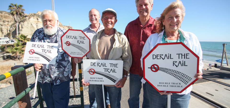 From left: Local activists Kenny Nielsen, Bill Hunt, Bob Joseph, John Dorey and Kathryn Stovall Dennis stand near the Calafia Beach pedestrian crossing. Calafia, along with the city's other pedestrian crossings, may soon be quiet zones, where train horns would no longer be required to sound. The group was also part of previous movements that prevented double tracking on San Clemente's beaches and halted the original design of the Coastal Trail. Photo: Allison Jarrell