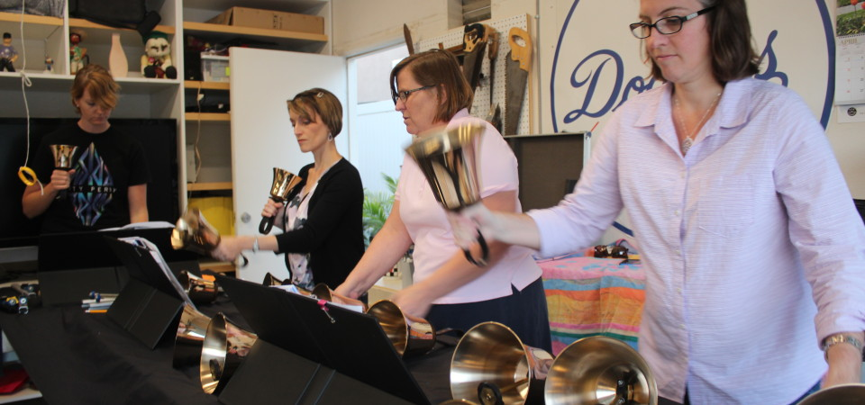 Members of the San Clemente Community Handbell Choir Sabrina Vasta (L to R) Sharon Guilliams and Emily Bredthauer rehearse for Sunday's concert in Guilliams' garage. Photo: Jim Shilander