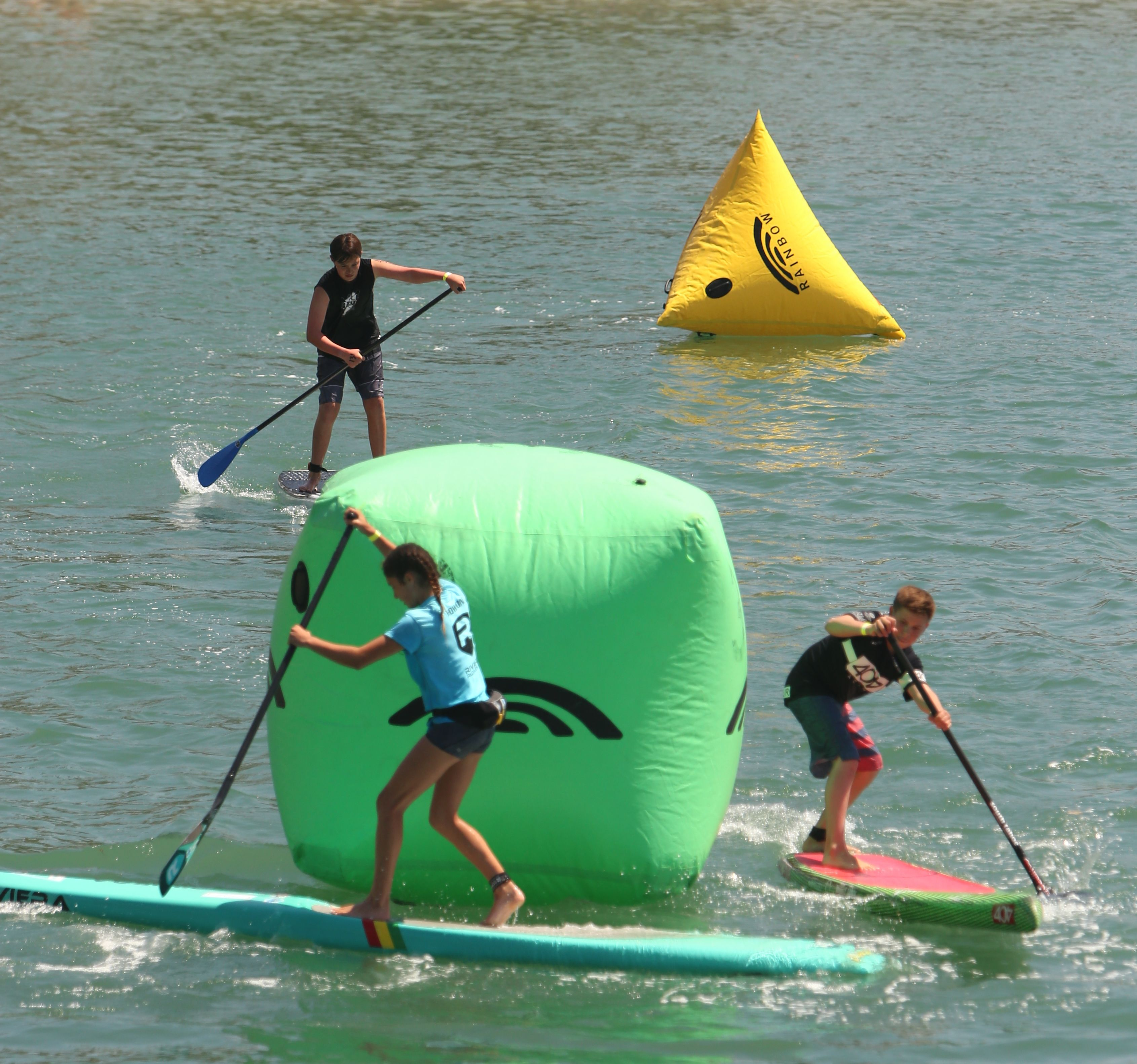 Youth racers round a buoy at the Mickey Munoz Mongoose Cup, Dana Point, April 18, 2015. Photo: Bill Schildge