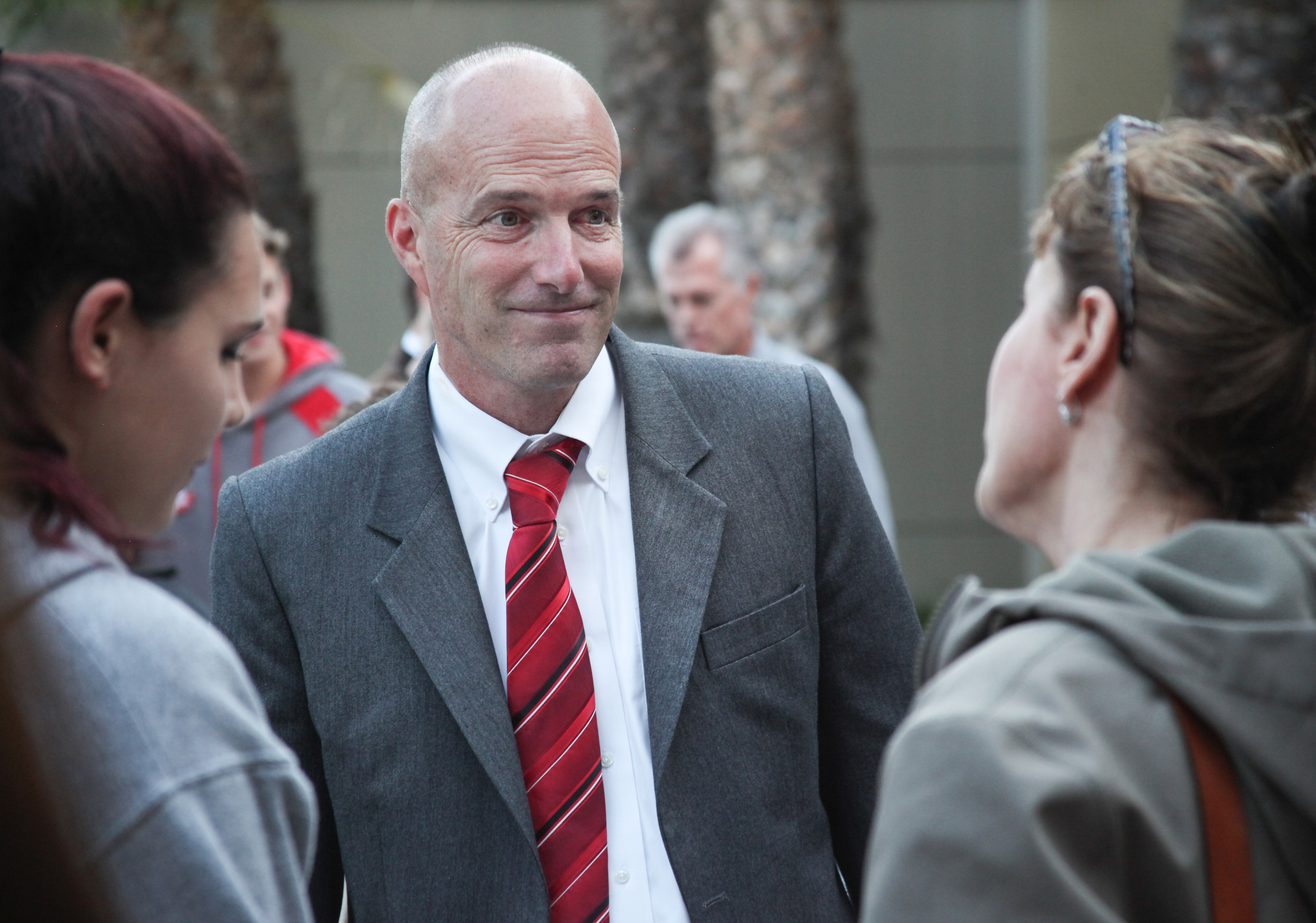 Principal Michael Halt speaks with people following the June 4 CUSD meeting. Halt was reinstated as a district principal, but was not offered his former position at San Clemente High School. On Thursday, San Clemente Times received a letter from the district that stated Halt had refused employment offers from CUSD. Photo: Allison Jarrell