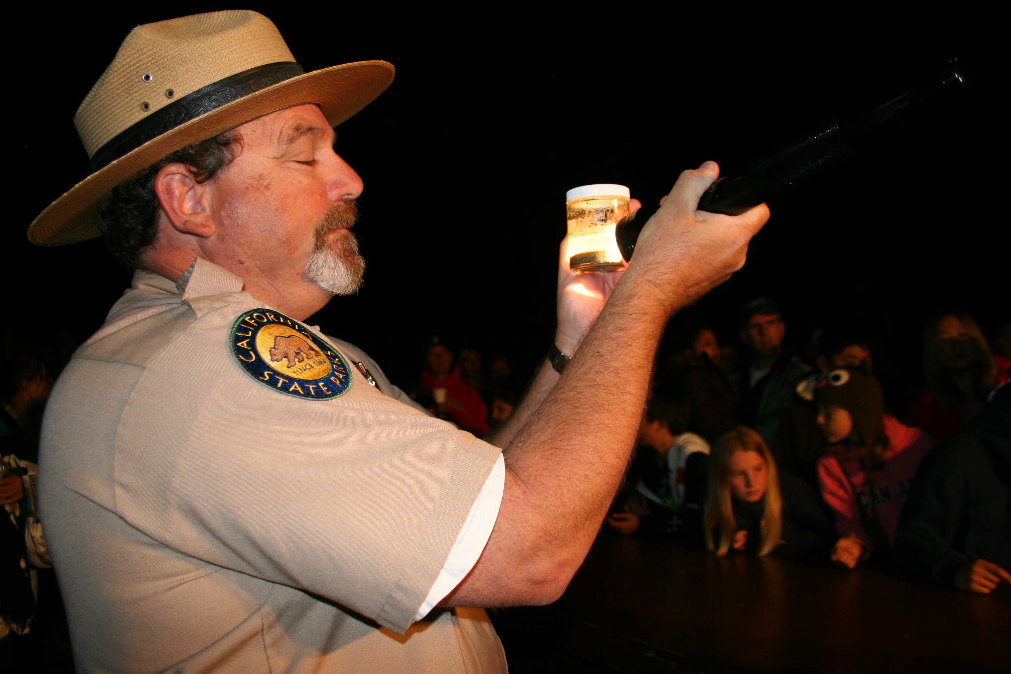 Park Ranger Jim Serpa talks about the grunion life cycle during last year's Grunion Night presentation. Photo: Andrea Swayne