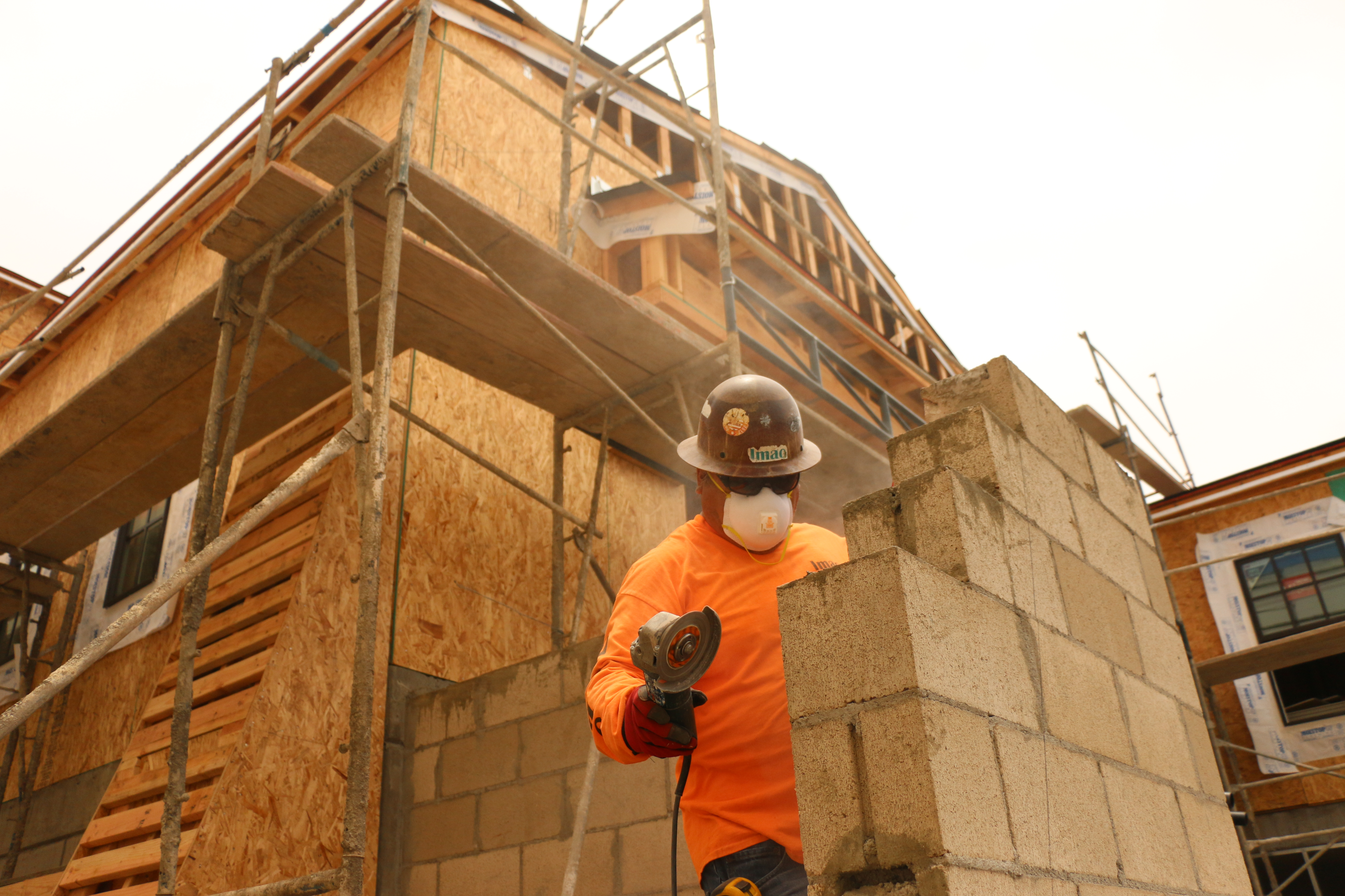 Jose Trujillo of Imac Construction works on a wall Friday, June 12 at the Avenida Serra affordable housing units. The complex is expected to receive applicants for wait lists later this month or in July. Photo: Eric Heinz