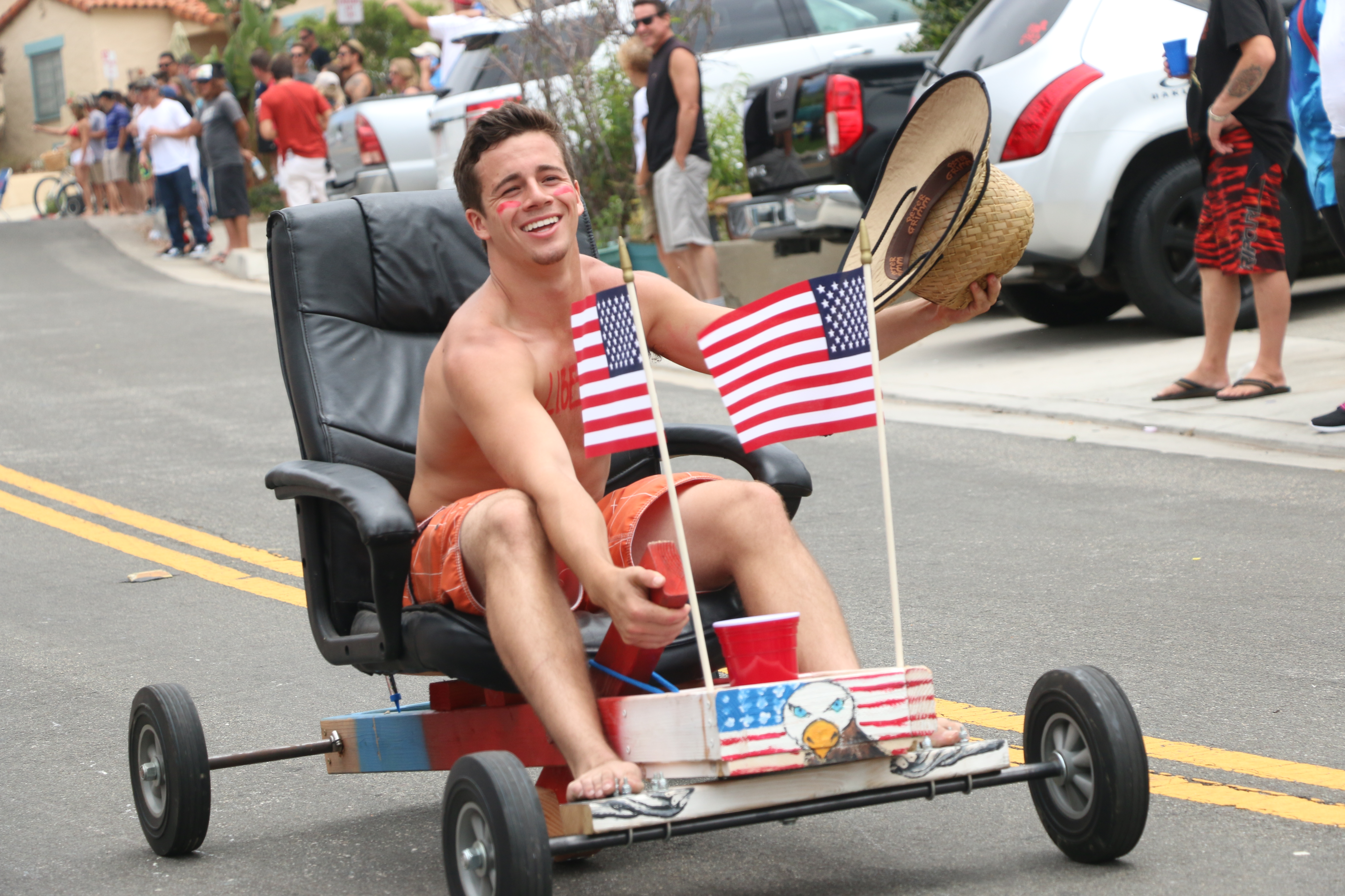 Office chair races take place in San Clemente on Fourth of July. Photo: Eric Heinz