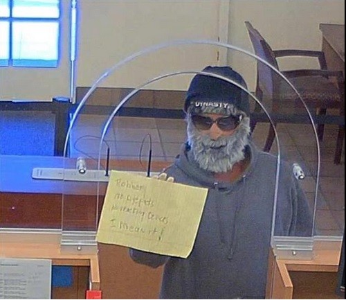 Photo2: A man holds up a sign demanding money from a bank teller Thursday morning at a Wells Fargo in Mission Viejo. The suspect is listed by OCSD as a resident of San Clemente. Photo: Courtesy of Orange County Sheriff's Department