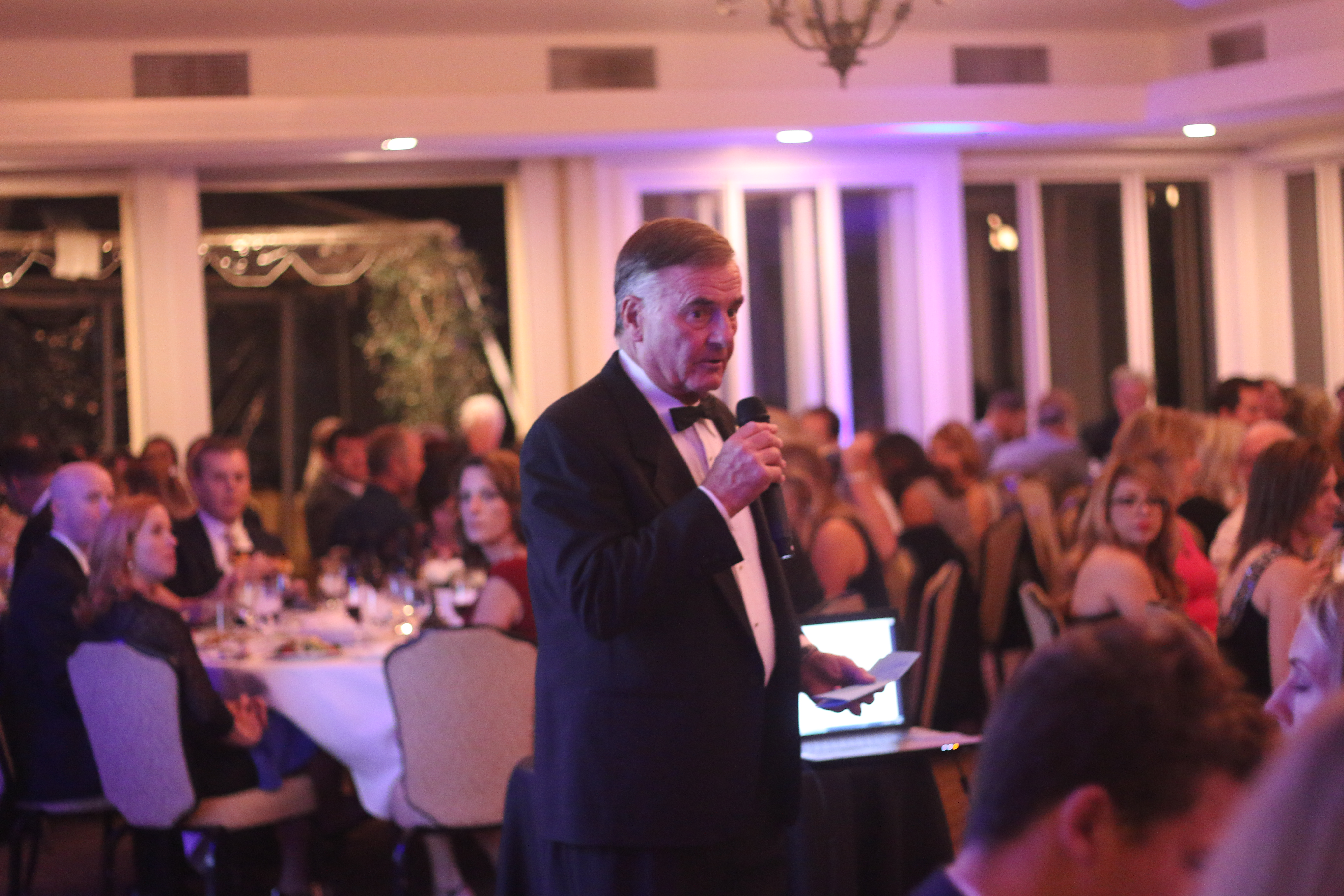 Don Brown speaks to the audience before the live auction begins during the Boys & Girls Club annual gala Saturday, Nov. 21 at Bella Collina Towne & Golf Club
