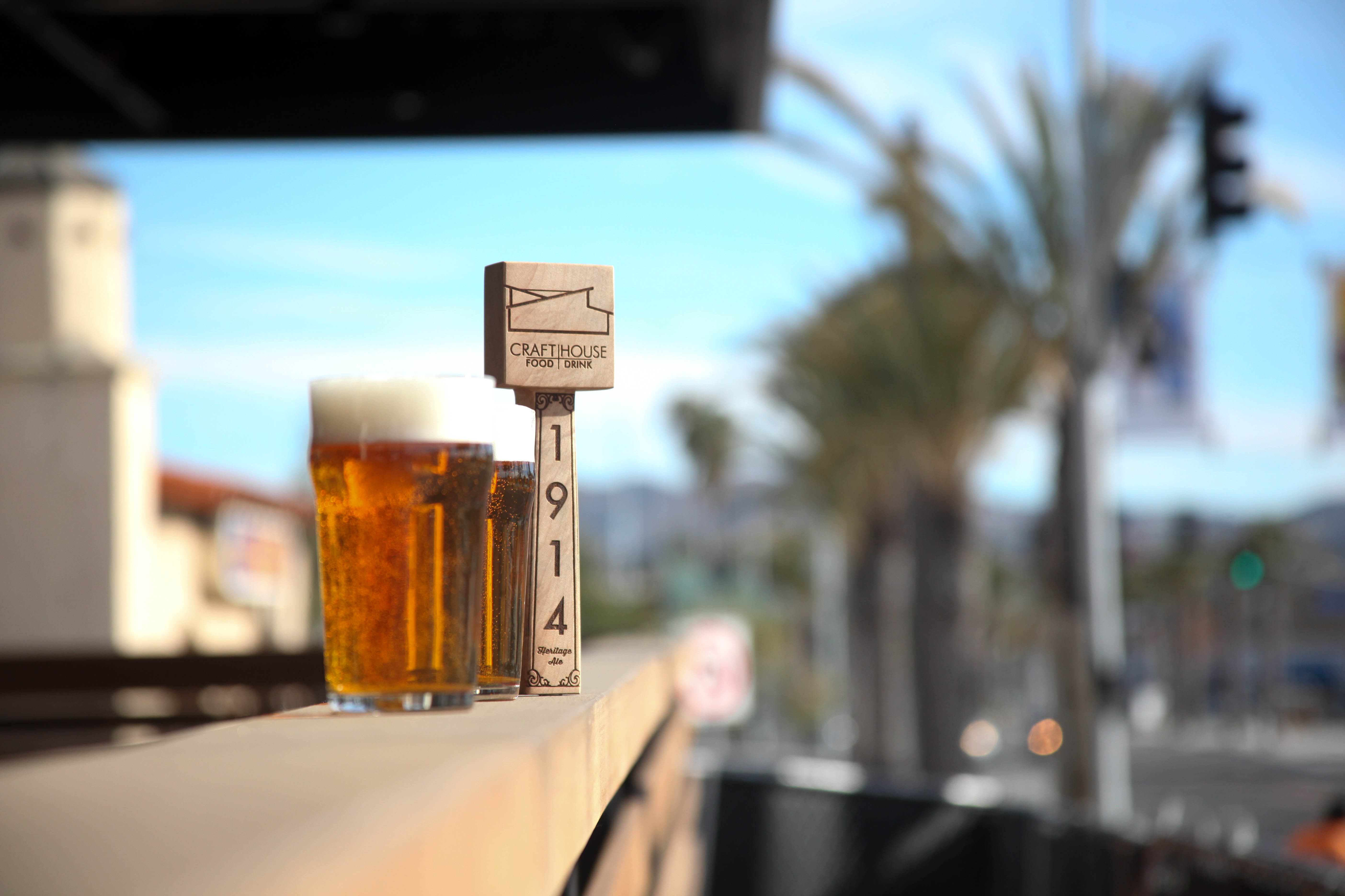 The Craft House's custom tap handle—made to dispense their house beer, 1914 Heritage Ale—is displayed on the restaurant's patio.