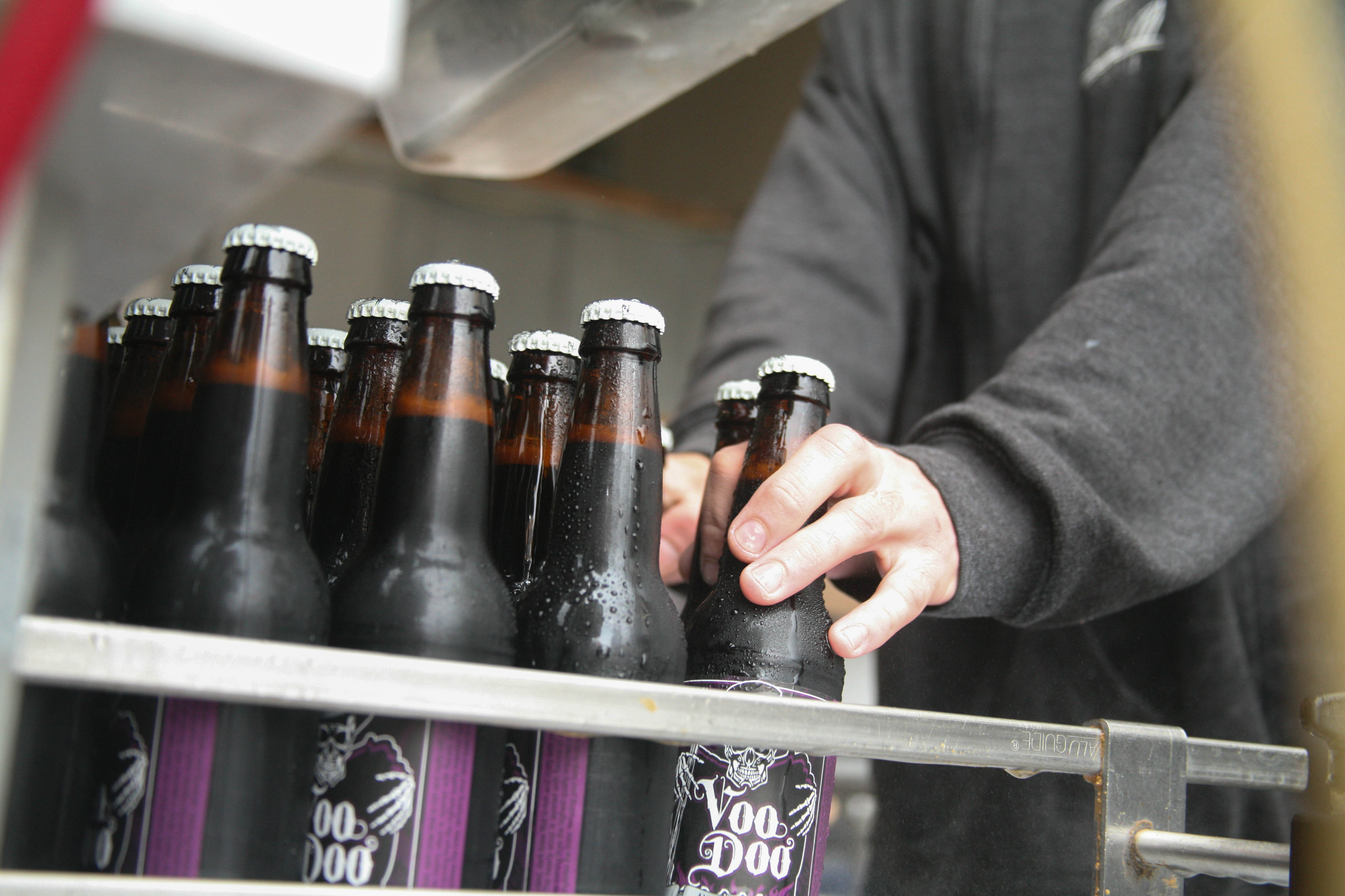 Left Coast Brewing Company's Voo Doo Stout is bottled and packaged by hand at their brewing facility and tap room in San Clemente.