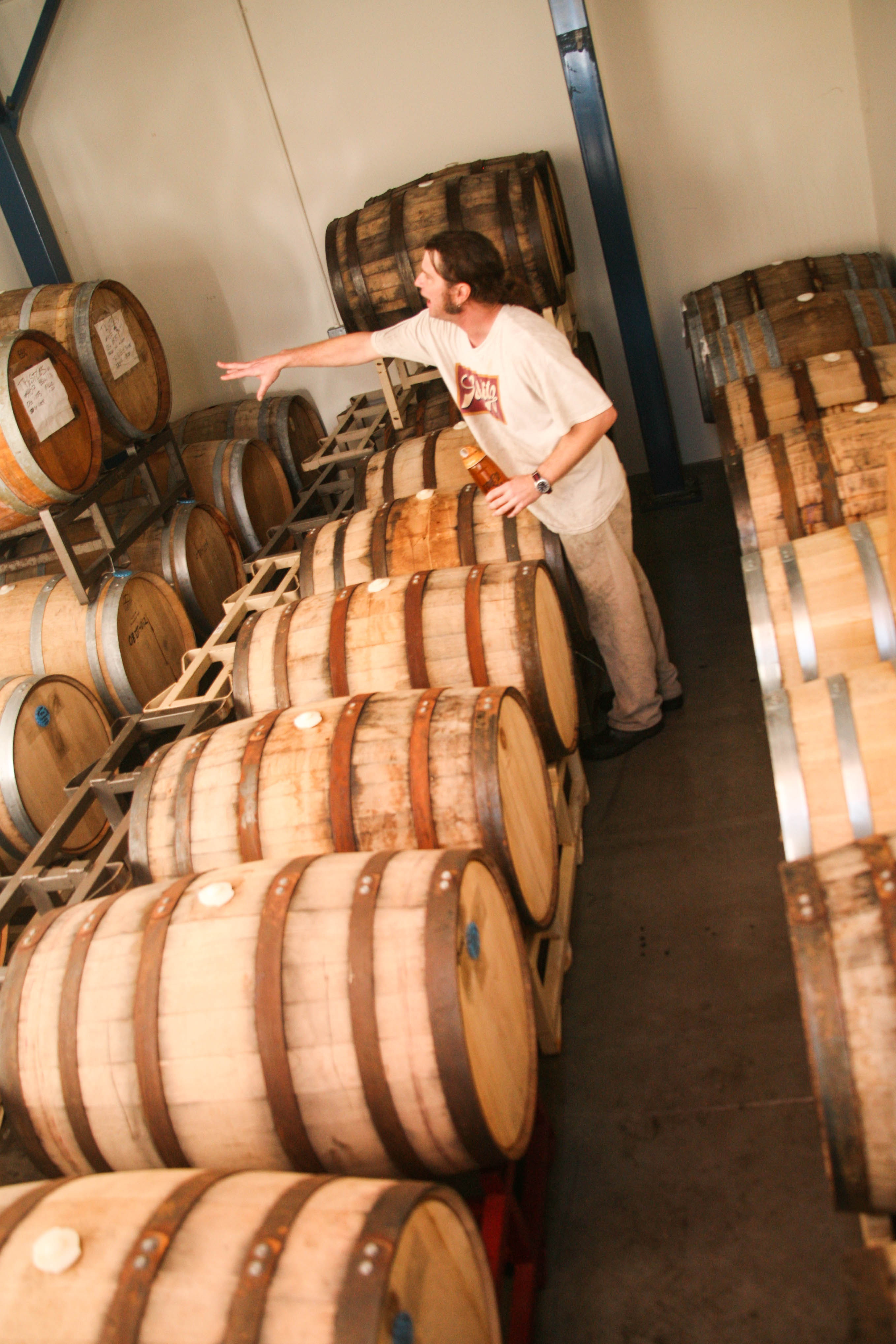 Jim Clarke, head brewer of Left Coast, explains the different beers aging in their barrels.
