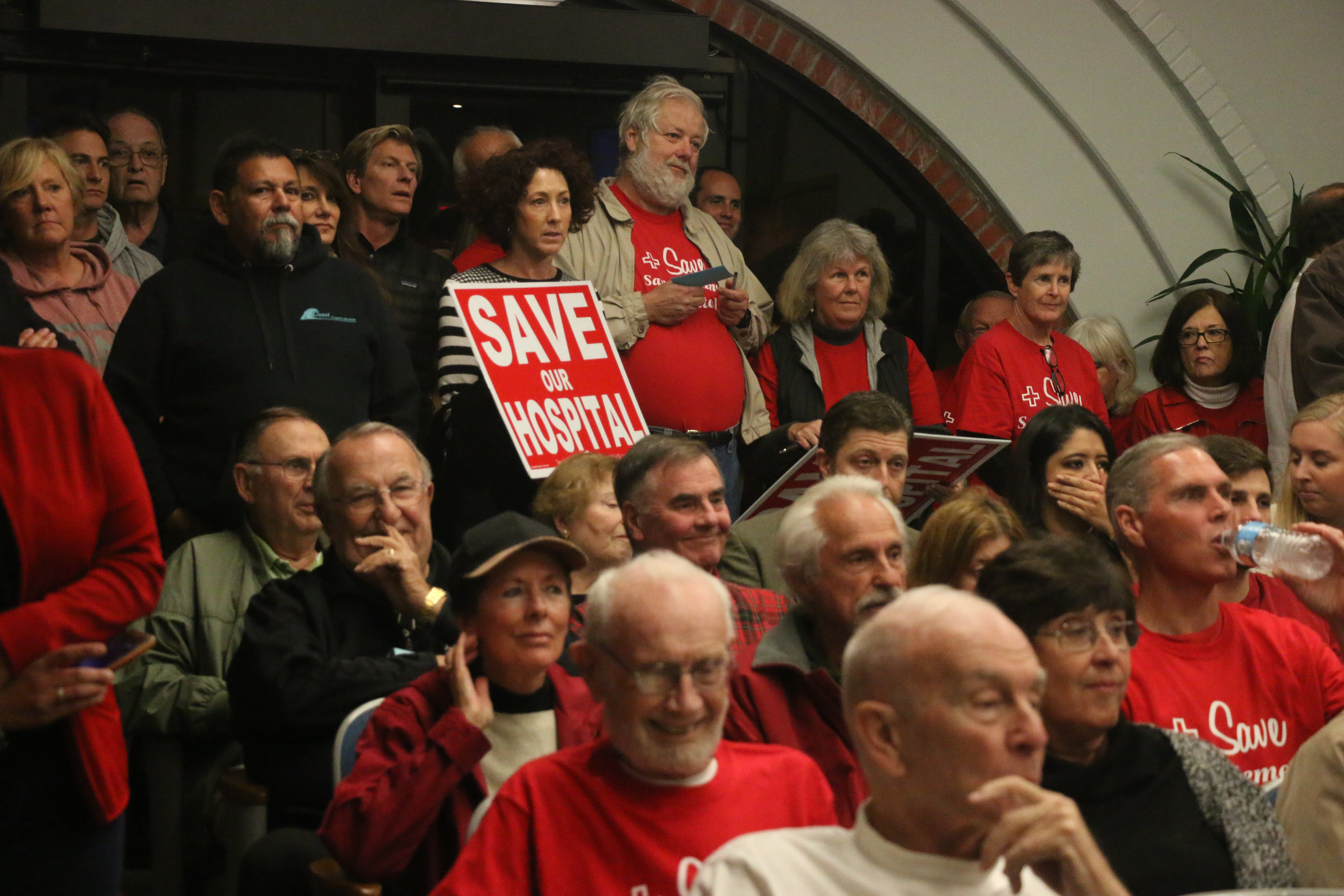 Members of the Save San Clemente Hospital Foundation arrived in droves with signs and wearing red shirts at the Tuesday night City Council meeting. Photo: Eric Heinz