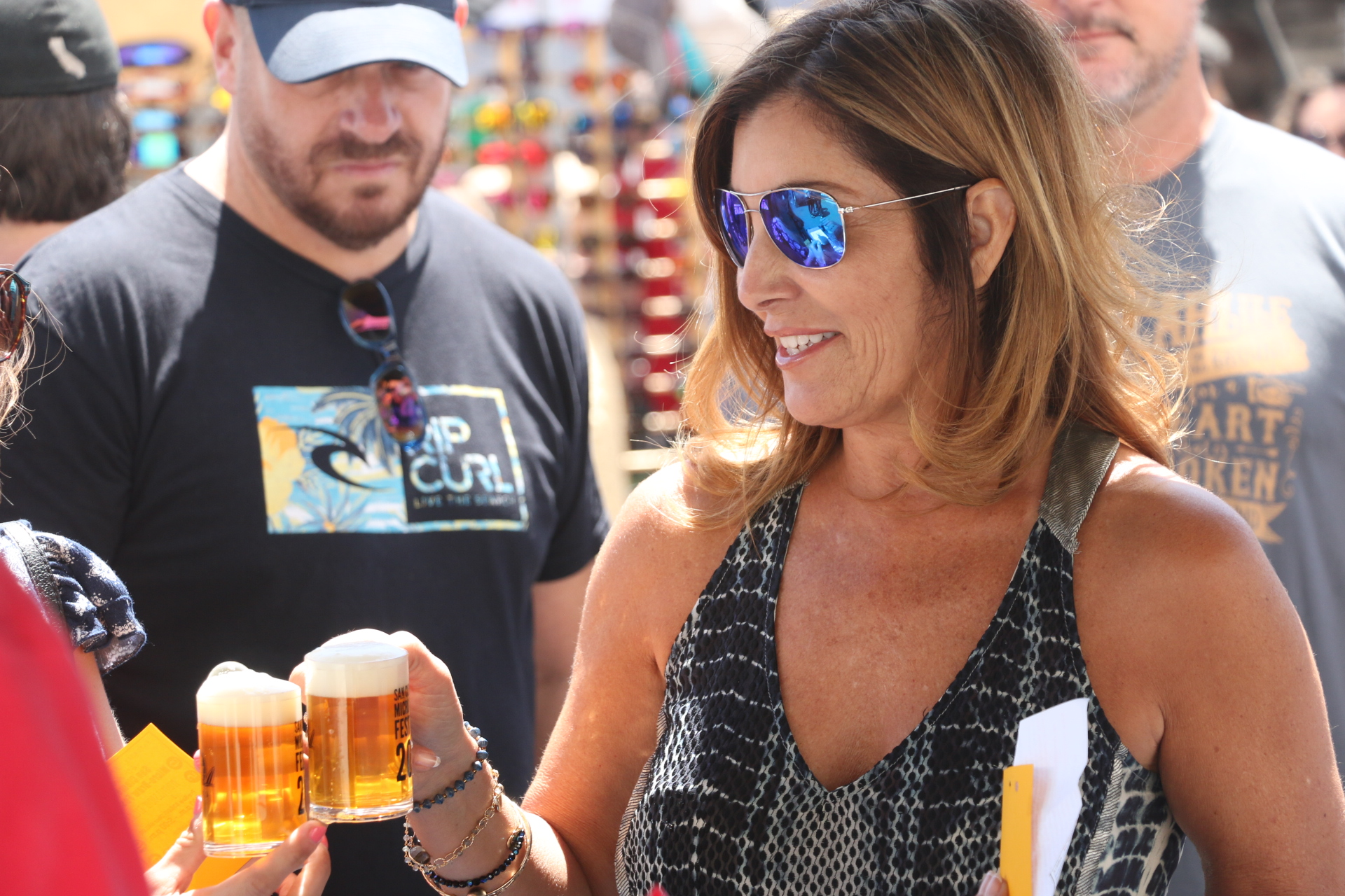 Julie Ragenovich toasts a fellow patron at the San Clemente Micro-Brew Fest on Saturday, April 23. Photo: Eric Heinz