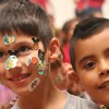 Breden Varela, 7, left, shows off his stickers with Jesus Gutierrez during the Keller Williams RED Day at the Boys & Girls Club of the South Coast Area.