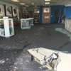 The AT&T store at 638 Camino de Los Mares was left damaged, and one person was struck, by a car that was driven through the front of the store Thursday afternoon. Photo: Eric Heinz