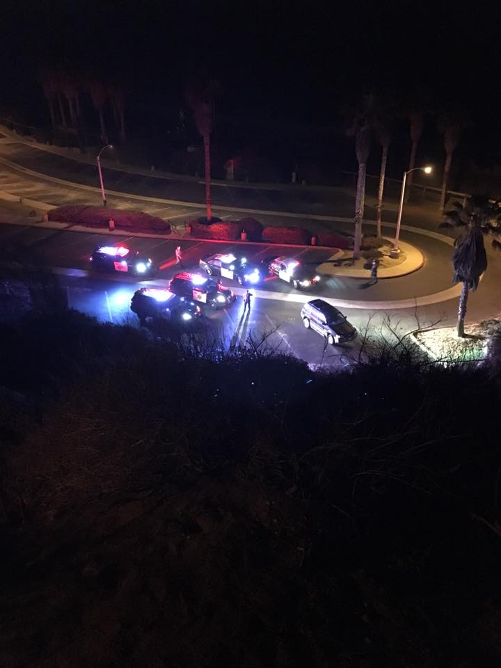 Police officers are seen naer the end of Avenida Calafia sometime around midnight in San Clemente. Officers are searching for a man who fled from them late Tuesday night and into Wednesday morning. Photo: Courtesy of Geoff Glen