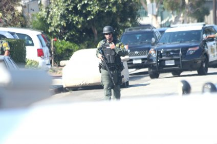 Orange County Sheriff's Department deputies set up a perimeter Friday morning around the 100 block of W. Avenida Canada after they received reports of a man shooting at a vehicle. Photo: Eric Heinz