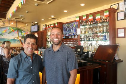Victor Avlia, left, and his son, Marcus, will host a celebration of the restaurant chain's 50th anniversary on Thursday, Sept. 1. Photo: Eric Heinz