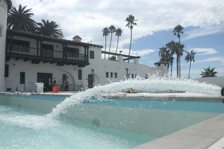 Water is poured into the refurbished baby pool at the Ole Hanson Beach Club. Both the large pool and the baby pool have been completely redone. Photo: Eric Heinz