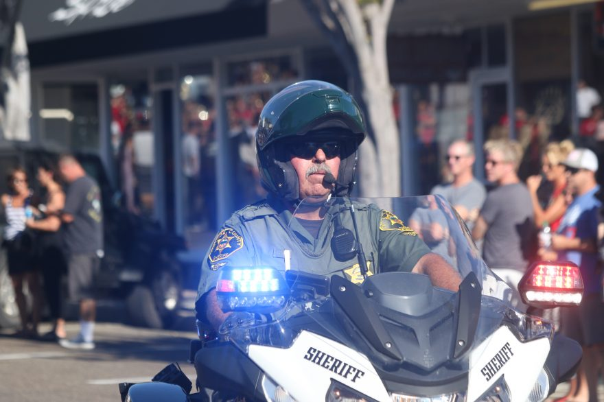 A motorcycle patrol officer with Orange County Sheriff's Department leads the Red Ribbon Parade on Monday, Oct. 24. Residents of San Clemente gathered at a meeting Tuesday, Oct. 25, to discuss their desire for more law enforcement in the city. Photo: Eric Heinz