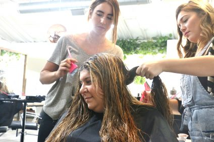 Madeline Call, left, and Lia Wetzel work on Kristen Frasco's hair Tuesday, Oct. 18 at Wheeler Davis Salon in San Clemente. The business was started by Jason and Lauren Wheeler, who self-funded their own venture. Photo: Eric Heinz