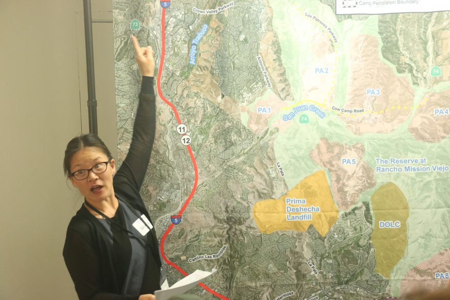 Juliet Su, a staff member with Get Moving Orange County, explains some of the proposals put together by the Transportation Corridor Agencies during a community meeting Oct. 5 at St. Andrews by-the-Sea in San Clemente. Photo: Eric Heinz