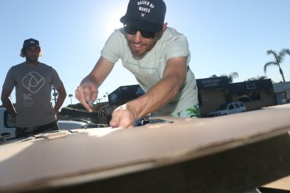 François Jaubert makes specific cuts to a piece of cardboard he made into a surfboard on Friday, Nov. 4, in San Clemente's surf ghetto. Photo: Eric Heinz