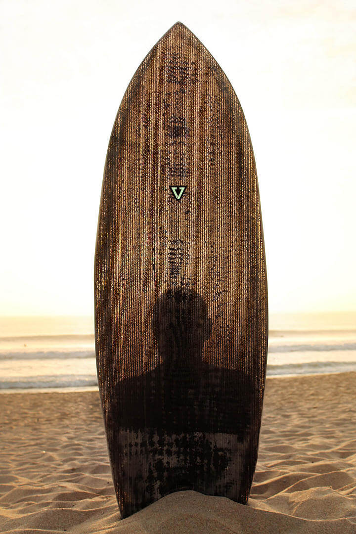 The surfboards made out of cardboard are basically translucent, as the outline of a man can be seen through the broadside of the board. Photo: Courtesy of François Jaubert