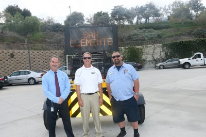 From left, city of San Clemente officials Lawrence Brotman, Dave Rebensdorf and Mark Iverson stand in front of the TrafFix Devices, Inc., Scorpion Trailer Attenuator, which helps cushion the impact of vehicles to the back of large vehicles used in public works. TrafFix has been in business for 30 years. Photo: Eric Heinz