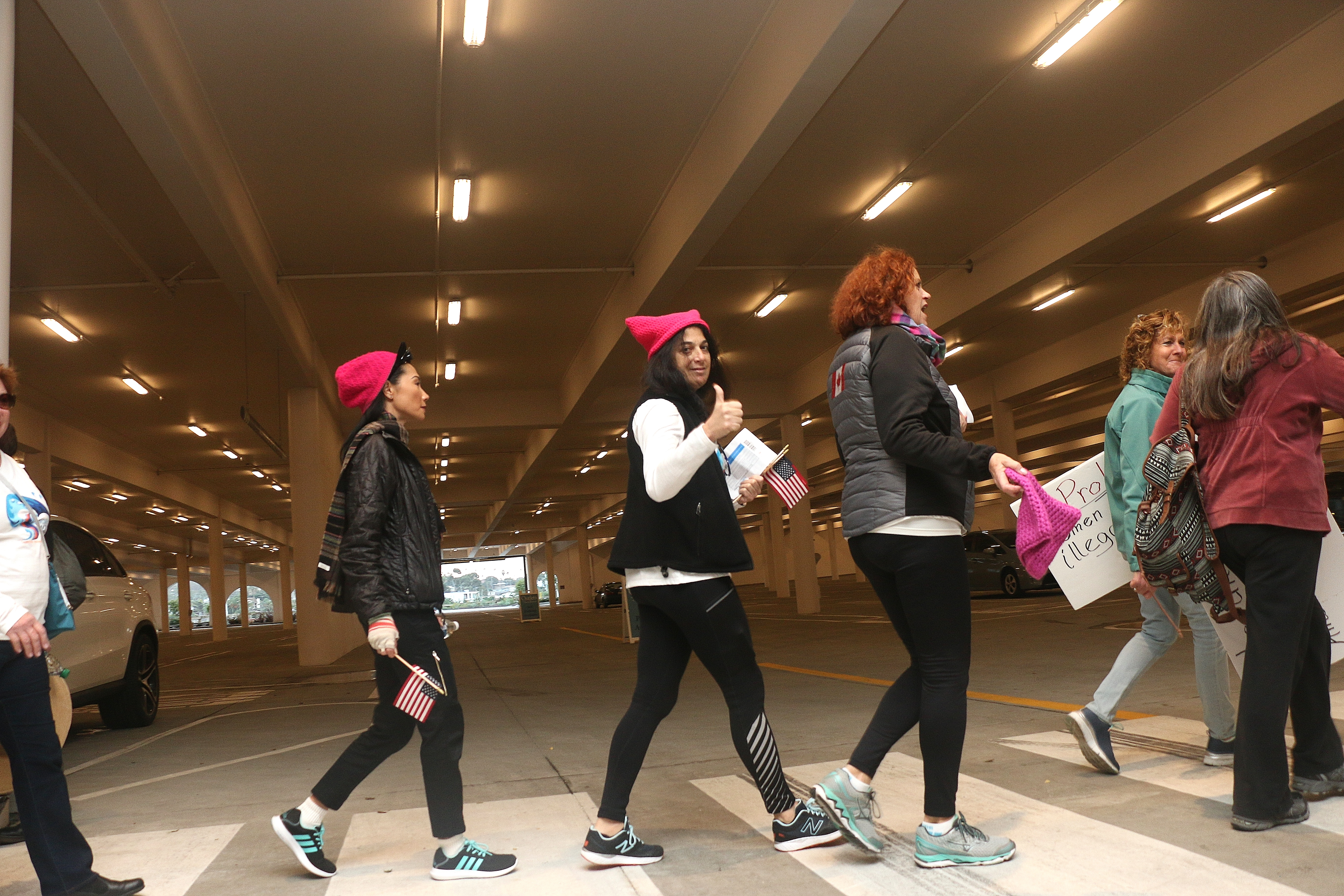 "Marchers make their way to the buses to take them to Santa Ana to participate in the ""sister march"" in solidarity with the Women's March on Washington. Photo: Eric Heinz"