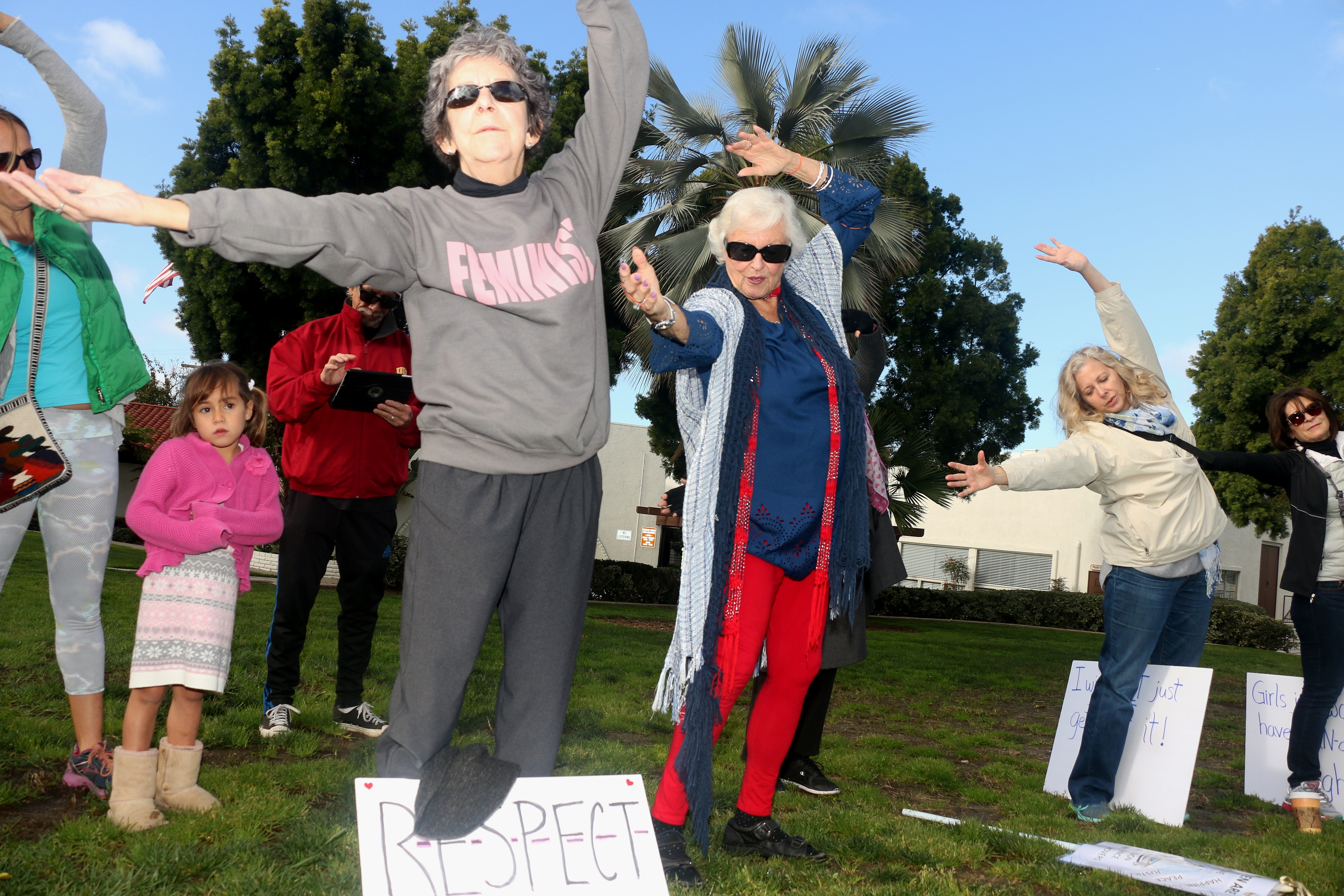 Tias Hoffman, standing center in a blue shirt and red pants, leads marchers through warm-up tai chi exercises on Saturday, Jan. 21, at the San Clemente Community Center. Hoffman organized the San Clemente march. Photo: Eric Heinz