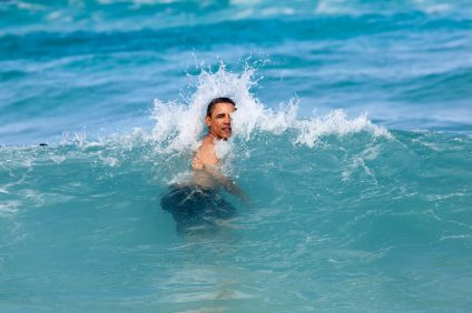 President Barack Obama swimming at Pyramid Rock Beach in Kaneohe Bay on New Year's Day, 2012, during his annual Christmas holiday with family and friends. Photo: Pete Souza/Wikimedia Commons