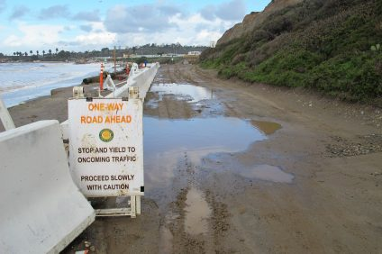 A section of the road collapsed at Surf Beach earlier this month, limiting access for local surfers. Photo: Jake Howard
