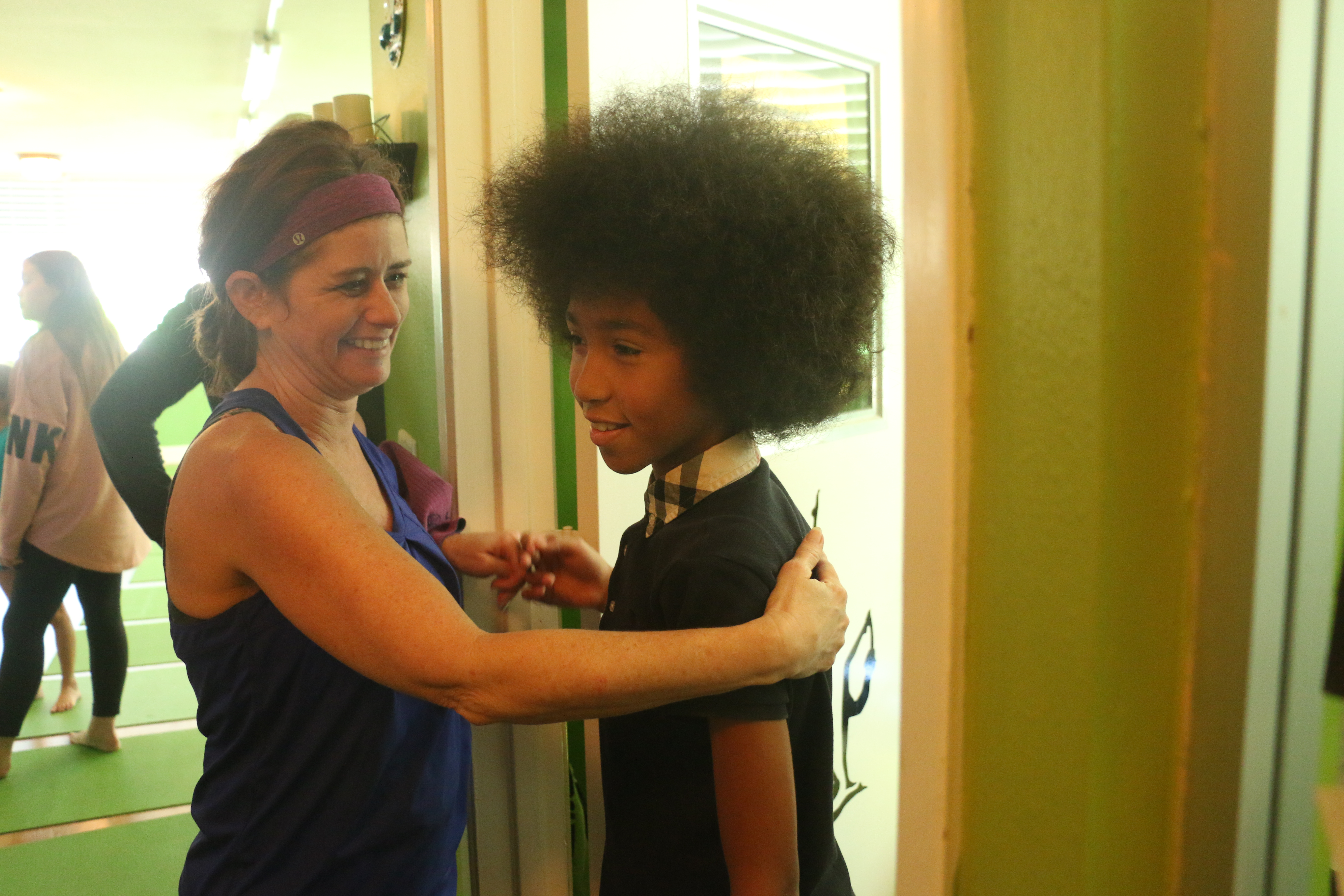 Kim Hanley, a teacher at Vista Del Mar Middle School, gives a hug to her English student Larry Tabay Atkins IV, who gave her a yoga lesson at his mother's studio, care4yoga, on Saturday, Jan. 14, in San Clemente. Photo: Eric Heinz