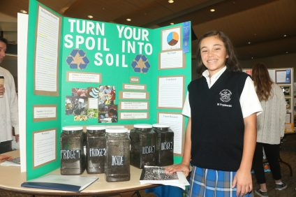 Willa Poplawski, 12, measured the rate of biodegradable material over time and presented her findings at the Our Lady of Fatima Parish School science fair on Sunday, Jan. 29.