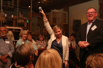 "Brenda Wells, president and founder of the i-5 Freedom Network, holds up the microphone for the audience to respond when she asked them to repeat the National Human Trafficking Hotline number during the network's fundraiser ""Be a Big Cheese"" on Monday, Jan. 30, at The Cellar. Photo: File"