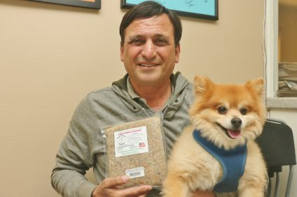 Elias Alawi and his dog, Ted, pose for a photo. Alawi has been making his own customized food for dogs for about three years and launched a new line of the food recently. Photo: Eric Heinz